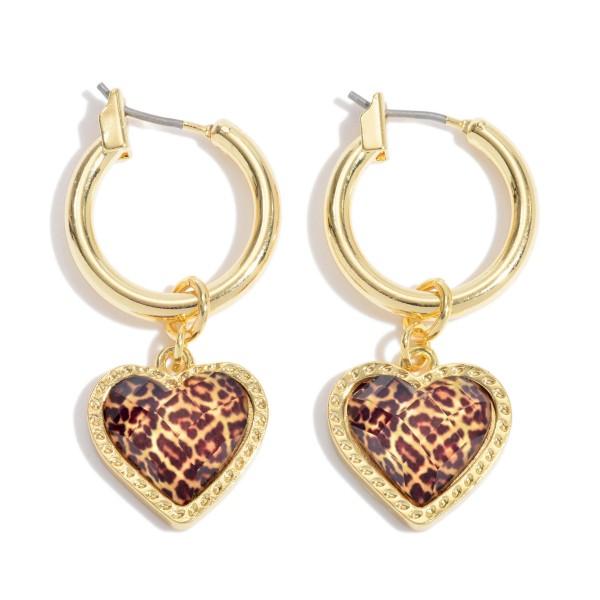 "Leopard Print Heart Hoop Earrings in Gold.  - Heart .5'  - Hoop Diameter .75""  - Approximately 1.5"" in Length"