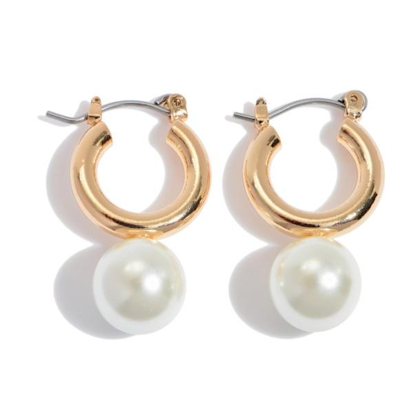 """Ivory Pearl Hoop Earrings in Gold.  - Pearl 9mm - Hoop Diameter .5'  - Approximately 1"""" in Length"""