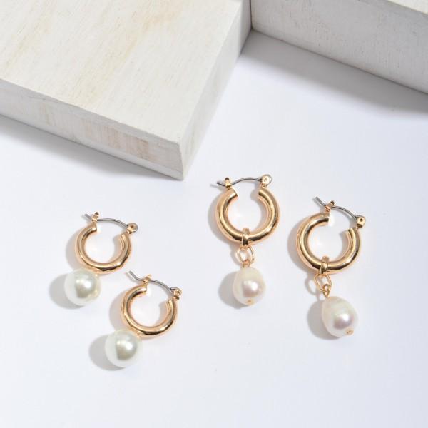 """Ringed Ivory Pearl Hoop Earrings in Gold.  - Pearl 8mm - Hoop Diameter .5""""  - Approximately 1.25"""" in Length"""
