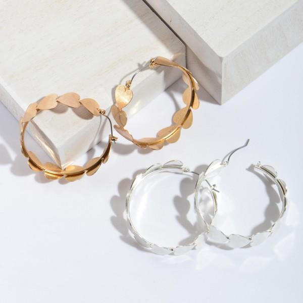 "Metal Heart Hoop Earrings.  - Approximately .5"" W  - 2"" in Diameter"