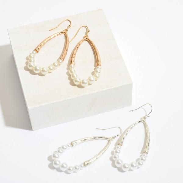 "Half Pearl Beaded Teardrop Earrings in a Gold Finish.  - Approximately 2.5"" in Length"