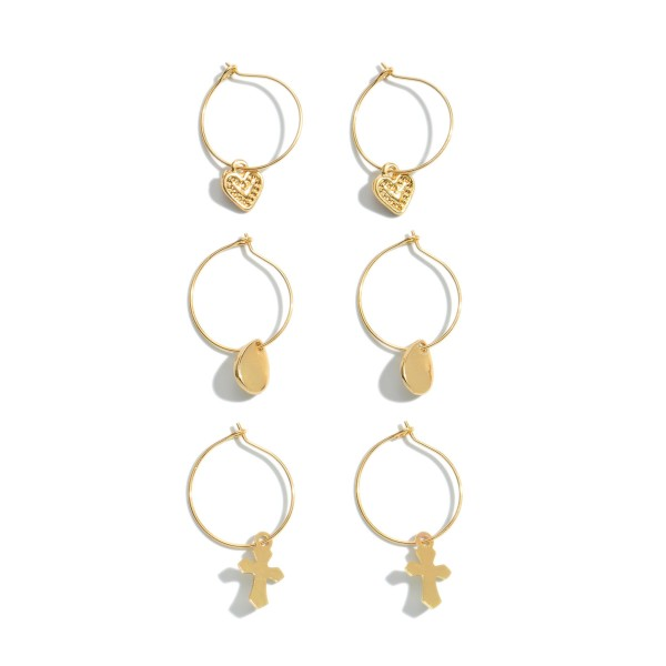 "3 PC Drop Hoop Earring Set in Gold.  - 3 Pair Per Set - Features: Hearts, Teardrops, & Crosses - Approximately 1"" in Hoop Diameter"