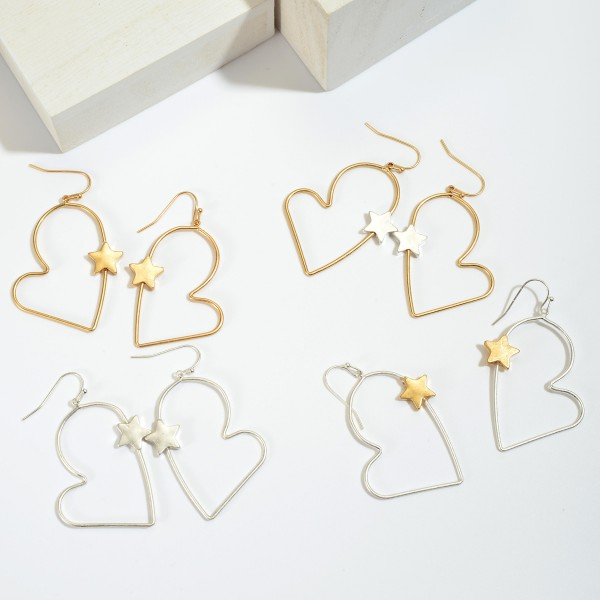 "Two Tone Heart Drop Earrings Featuring a Star Accent.  - Approximately 2.25"" in Length"
