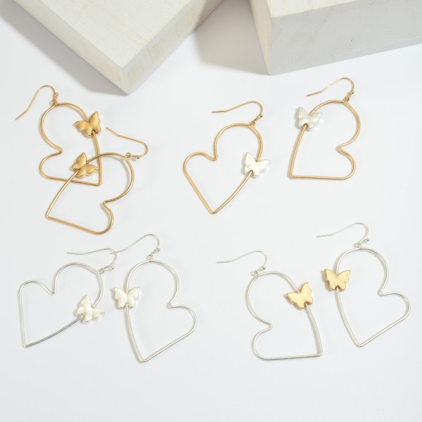 "Two Tone Heart Drop Earrings Featuring a Butterfly Accent.  - Approximately 2.25"" in Length"