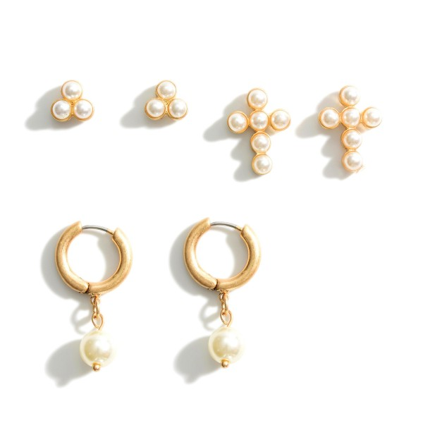 """Set of Three Pairs of Metal Earrings Featuring Faux Pearl Accents.   - Stud Earrings Approximately 6mm in Diameter - Cross Stud Earrings Approximately 1/2"""" in Length  - Metal Hoop Earrings Approximately 1"""" in Length"""