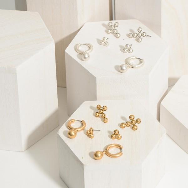 """Set of Three Pairs of Metal Earrings.   - Metal Studs are Approximately 6mm in Diameter  - Metal Cross Studs are Approximately 1"""" in Length  - Metal Hoop Earrings Measure Approximately 1"""" in Length"""