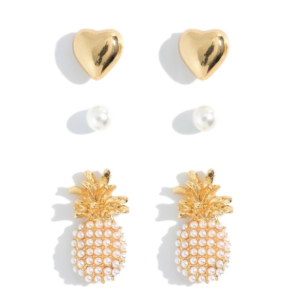 """Set of 3 Pairs of Gold Stud Earrings.   - Faux Pearl Studs Approximately 2mm in Diameter  - Gold Heart Studs Approximately 5mm in Diameter  - Pineapple Studs Approximately 1"""" in Length"""