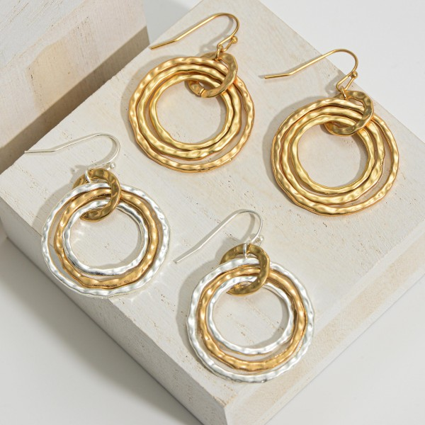 "Circular Metal Earrings Featuring a Hammered Texture.   - Approximately 1.5"" in Length"