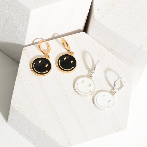 """Metal Hoop Earrings Featuring Smiley Face Accents.   - Approximately 1.5"""" Long"""