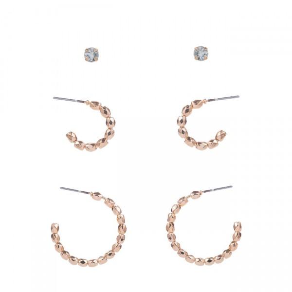"""Set of 3 Metal Earrings.   - CZ Studs Measure Approximately 1mm in Diameter -  Hoop Earrings Measure Approximately 1/2"""" & 1"""" in Diameter"""