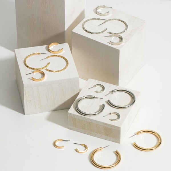 """Set of 4 Pairs of Metal Hoop Earrings.   - Size Range is Approximately 1/2"""" in Diameter - 1 1/2"""" in Diameter"""