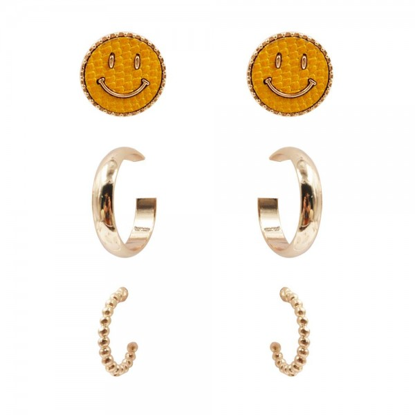 """Set of Three Pairs of Earrings.   - Smiley Face Studs Approximately 8mm in Diameter  - Solid Gold Hoops Approximately 3/4"""" in Diameter  - Textured Gold Hoops Approximately 1/2"""" in Diameter"""