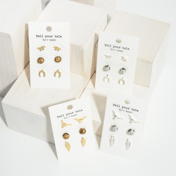 """Set of Three Pairs of Western Stud Earrings.   - Cow Skull Studs 1/2"""" Long  - Rhinestone Studs Approximately 4mm in Diameter - Feather Studs Approximately .75"""" Long"""