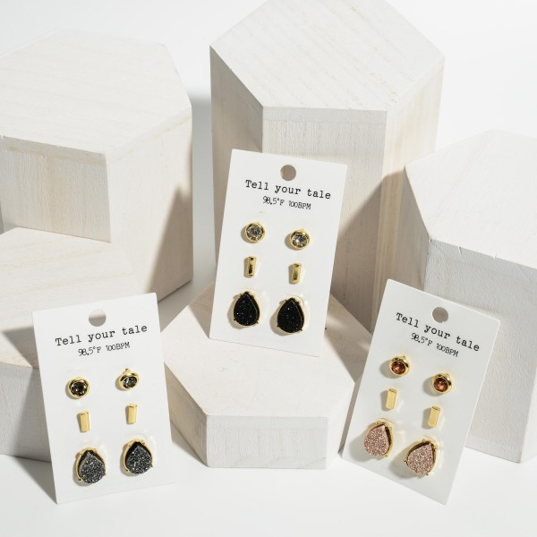 """Set of Three Pairs of Gold Stud Earrings Featuring Rhinestone and Cubic Zirconia Accents.   - Rhinestone Stud Earrings Approximately 4mm in Diameter  - Bar Stud Earrings Approximately 1/2"""" in Length  - Teardrop Stud Earrings Approximately 3/4"""" in Length"""