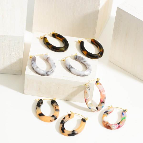 "Oval Shaped Resin Hoop Earrings.   - Approximately 2"" in Length"