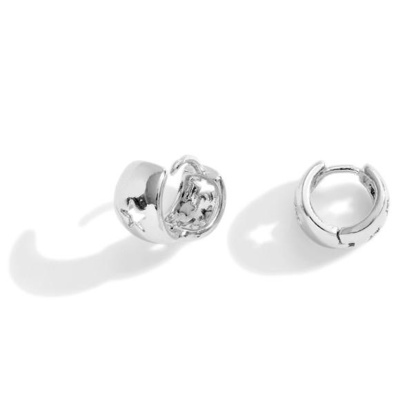 Small Metal Huggie Hoop Earrings Featuring Star Details.   - Approximately 5mm in Diameter