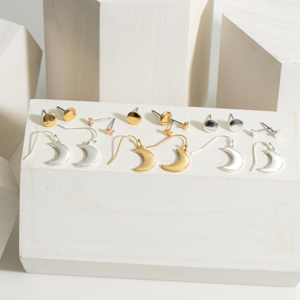 Set of Three Celestial Themed Metal Earrings.  - Star Studs Measure Approximately .25cm in Diameter - Moon Drop Earrings are Approximately 2cm in Length