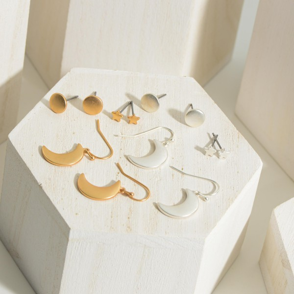 Set of Three Celestial Themed Metal Earrings.  - Star Studs Measure Approximately .25mm in Diameter - Moon Drop Earrings are Approximately 2cm in Length