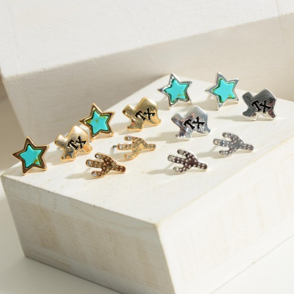 Set of Three Pairs of Texas Themed Earrings Featuring Turquoise Accents.  - Cactus Stud Earrings Approximately 1mm in Length - Star Studs Approximately 1cm in Diameter - Texas Studs Approximately 1cm in Diameter
