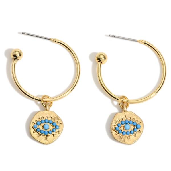 """Gold Hoop Earrings with Turquoise Evil Eye Charm.  - Approximately 1.5"""" in Length - Charm 1cm in Diameter - Hoop 1.75"""" in Diameter"""