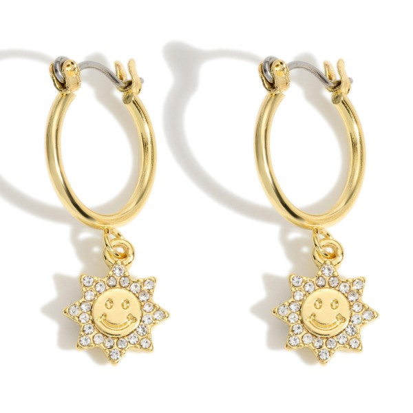 """Gold Hoop Earrings featuring a Rhinestone Sun Charm.   - Approximately 1.25"""" in Length"""
