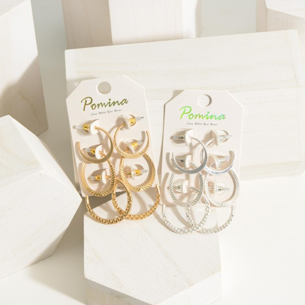 """Set of Three Metal Hoop Earrings.  - Hoop 1 Approximately 1"""" in Diameter - Hoop 2 Approximately 1.25"""" in Length - Hoop 3 Approximately 1.25"""" in Diameter"""