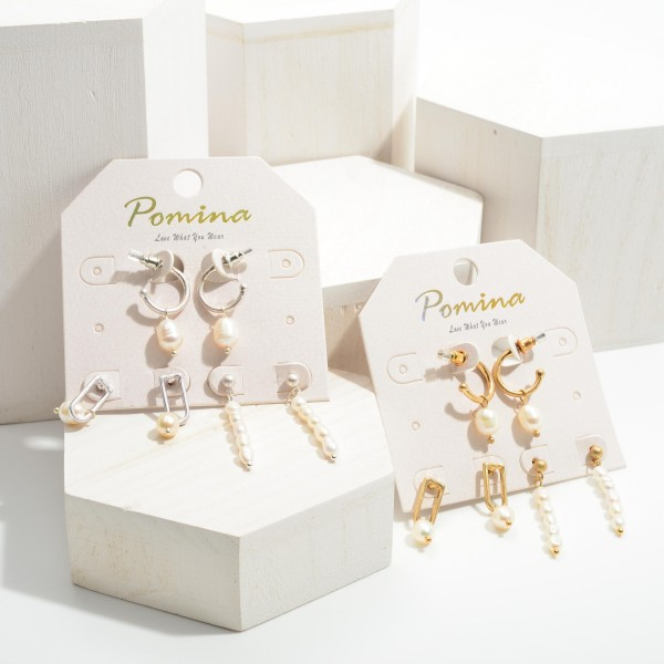 """Set of Three Drop Earrings Featuring Pearl Accents.   - Huggie Hoops Approximately .75"""" in Length - Gold Drop Earrings 1"""" in Length - Pearl Drop Earrings 1.25"""" in Length"""