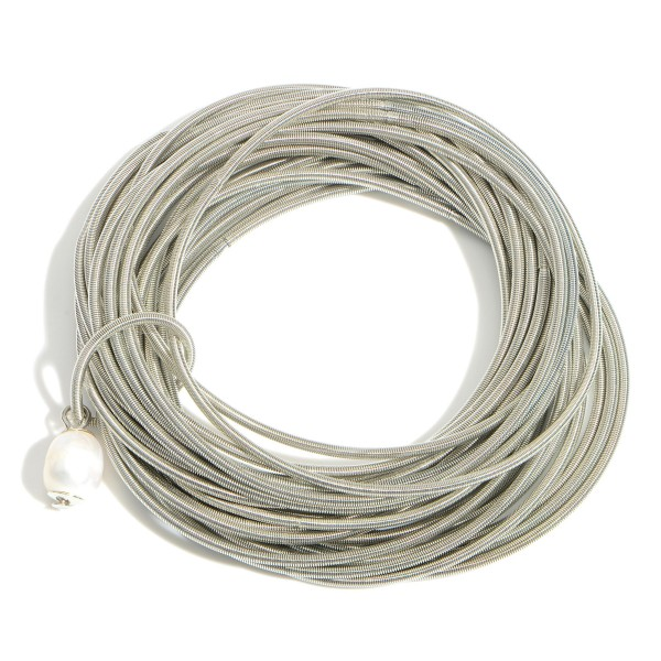 """Set of Twenty-Five Elastic Wire Bracelets Featuring Faux Pearl Accent.  - Approximately 3"""" in Diameter"""
