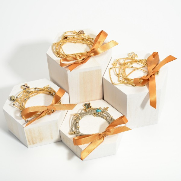 """Set of Seven Spring Wire Elastic Bracelets Featuring Natural Stone Accents and Texas Pendant.   - Approximately 3"""" in Diameter"""