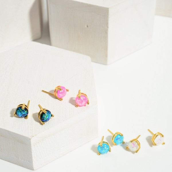 Gold Dipped Iridescent Stud Earrings.   - Approximately 5mm in Diameter