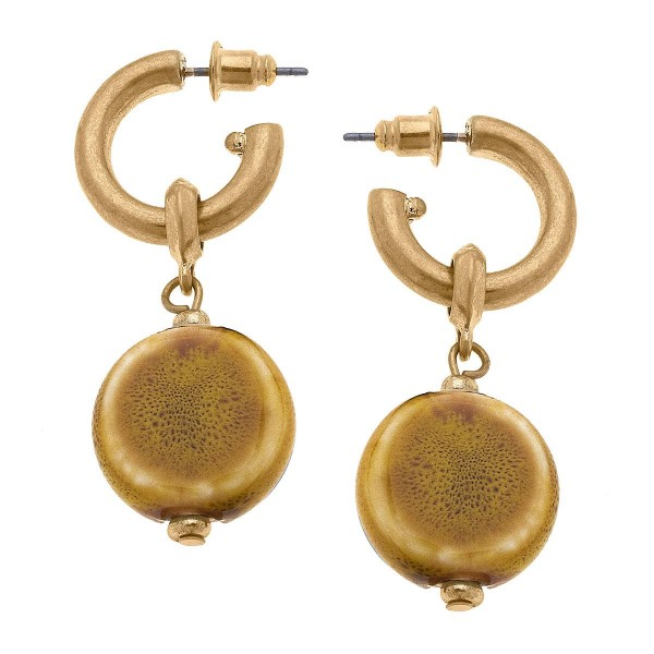 """Gold tone huggie hoop earrings with beaded drop.  -Approximately 1.5"""" in length"""