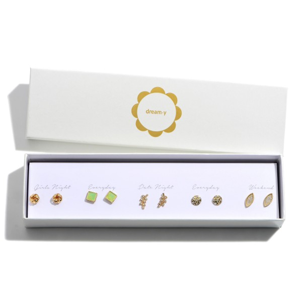 """Set of Five Gold Stud Earrings Featuring CZ Accents.   - Knot Studs Approximately .25"""" in Diameter - Mint Studs Approximately .5"""" in Diameter - Leaf Studs Approximately .75"""" in Length - Disc Studs Approximately .25"""" in Diameter - Oval Studs Approximately .75"""" in Length"""