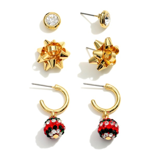 """Set of Three Christmas Earrings Featuring CZ Accents.   - CZ Stud Earrings Approximately .25"""" in Diameter - Bow Stud Earrings Approximately .75"""" in Diameter - Huggie Hoop Earrings Approximately 1.25"""" in Length"""