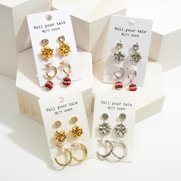 """Set of Three Christmas Earrings Featuring CZ Accents.   - Disc Stud Earrings Approximately .25"""" in Diameter - Bow Stud Earrings Approximately .75"""" in Diameter - Huggie Hoop Earrings Approximately 1"""" in Diameter"""