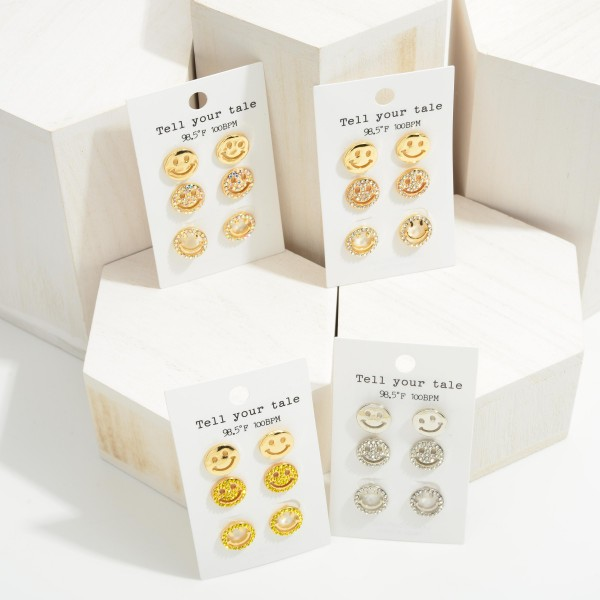 """Set of Three Smiley Face Stud Earrings Featuring CZ Accents.  - Studs Approximately .5"""" in Diameter"""