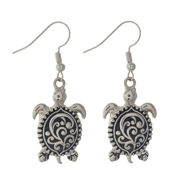 "Silver sea turtle earrings featuring a filigree design. Approximately 1 1/4"" in length."