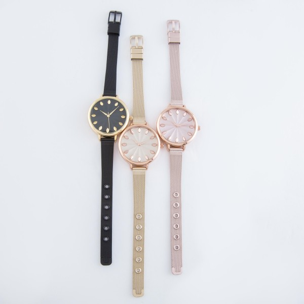 """Women's metal mesh band watch with adjustable closure.  - Adjustable closure - Case Size 35mm in diameter - Band Width 10mm - Approximately 3"""" in diameter"""