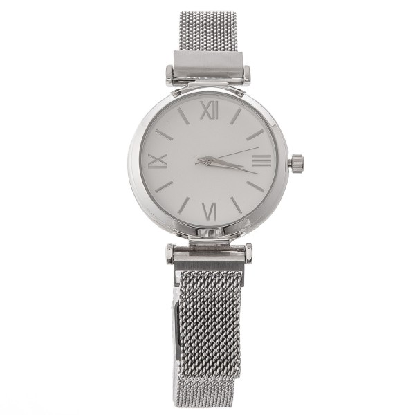 """Women's metal mesh watch with magnetic closure.  - Adjustable Magnetic Closure - Case Size 35mm in diameter - Band Width 12mm - Approximately 3"""" in diameter"""