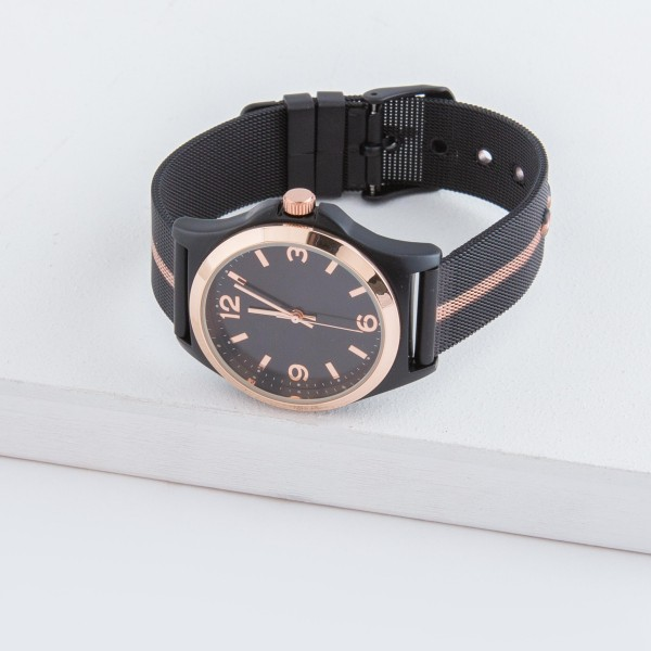 """Women's metal mesh band watch with stripe detail and adjustable closure.  - Adjustable closure - Case Size 35mm in diameter - Band Width 12mm - Approximately 3"""" in diameter"""