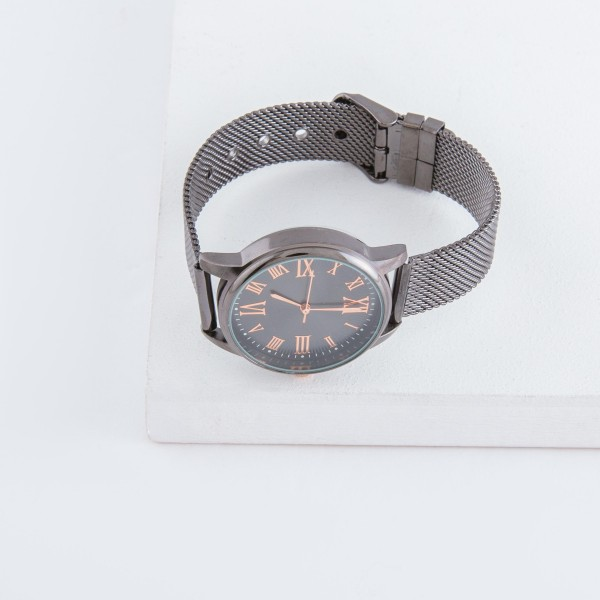 """Women's metal mesh band watch with adjustable closure.  - Adjustable closure - Case Size 30mm in diameter - Band Width 12mm - Approximately 3"""" in diameter"""