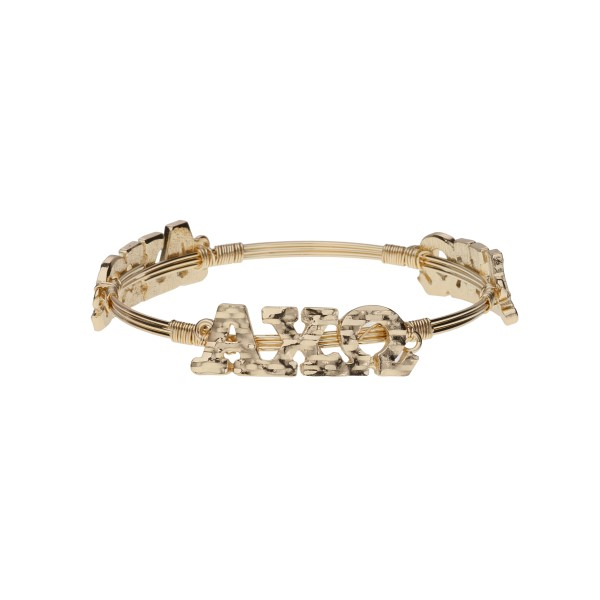 Gold tone Alpha Chi Omega wire wrapped bangle bracelet.