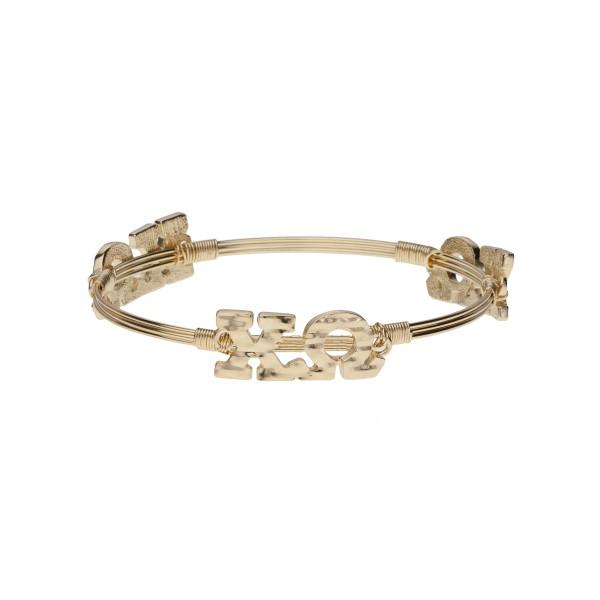 Gold tone Chi Omega wire wrapped bangle bracelet.