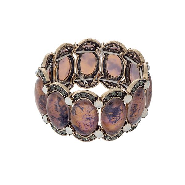 Wholesale burnished gold stretch bracelet displaying orange oval stones black di