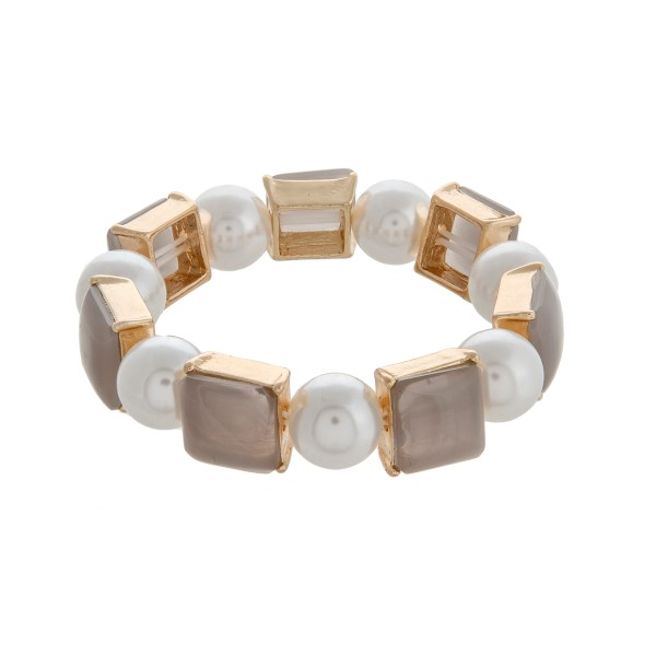 Faux ivory pearl stretch bracelet with gray square cabochons.