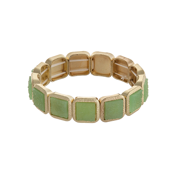 Gold tone square stretch bracelet with green stones.