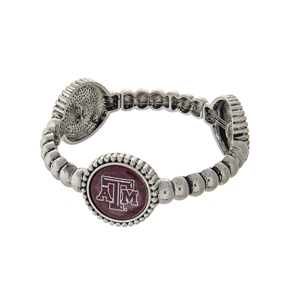 Officially licensed silver tone Texas A & M University stretch bracelet with three stations. Our exclusive design.