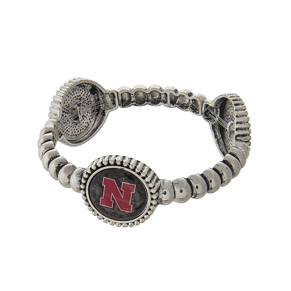 Officially licensed silver tone  University of Nebraska stretch bracelet with three stations. Our exclusive design.