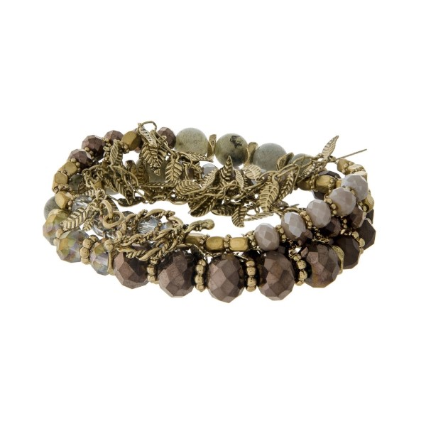 "Gold tone toggle bracelet with gold leaf charms, gray and brown beads. Can also be worn as a necklace. Approximately 24"" in length."