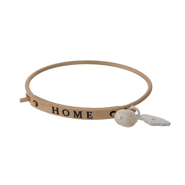"Gold tone bangle bracelet stamped with ""HOME"" and displaying the state of Illinois charm."