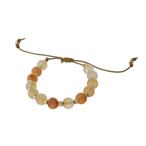 Brown cord adjustable bracelet with peach and gold beads. Handmade in the USA.